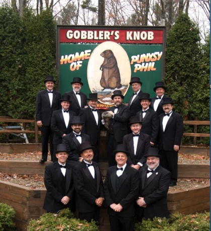 men in top hats with groundhog